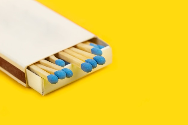 Wooden matches sticks with blue head in a match box isaolated Premium Photo
