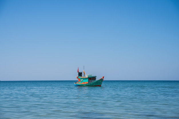 Wooden motor boat with a vietnamese flag Free Photo