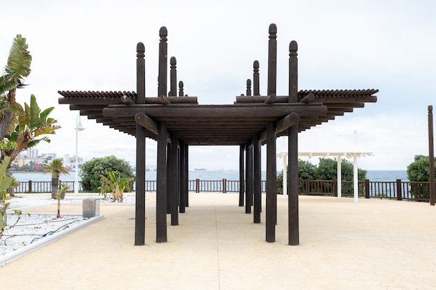 Wooden pergola located near a beach Premium Photo