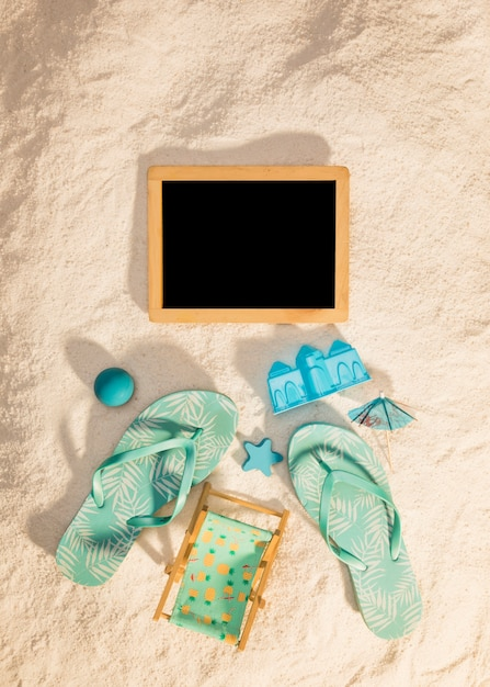 Wooden photo frame with blue beach attributes Free Photo