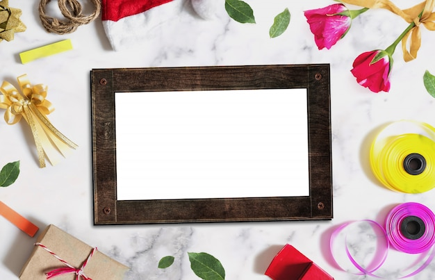 Wooden picture frame with christmas and valentines decorations on white concrete Premium Photo