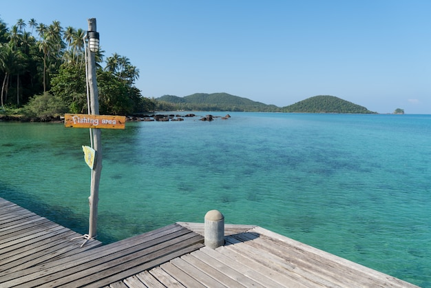 Wooden pier with summer blue sea and sky background in phuket, thailand. Premium Photo