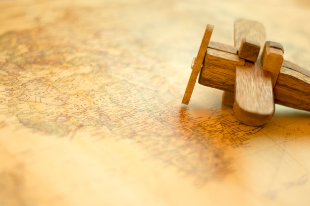 Wooden Plane On Vintage World Map Photo Premium Download - Vintage world map on wood