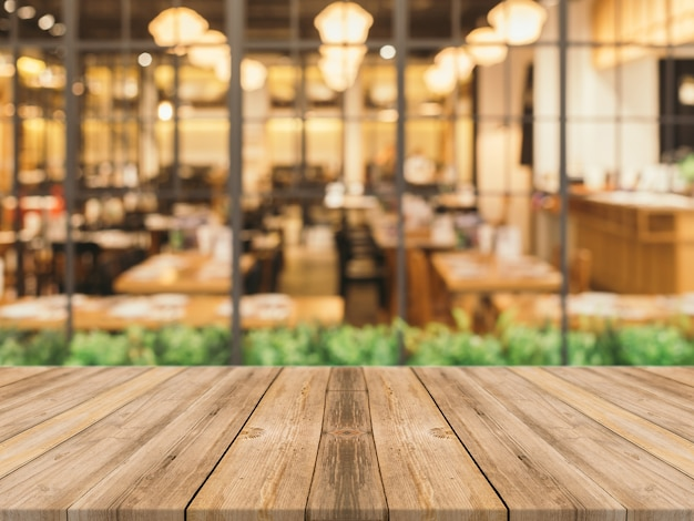Wooden planks with blurred restaurant background Free Photo