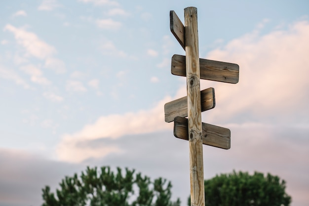 Wooden post with signs Premium Photo