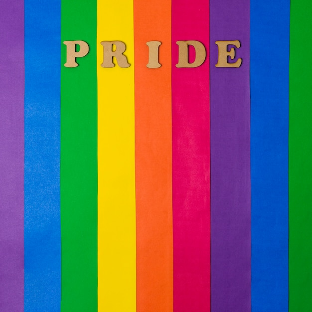 Wooden pride word and bright lgbt flag Free Photo