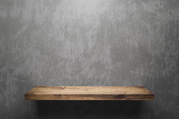 展覧会のコンセプトと灰色の壁の背景に木製の棚または製品の表示。木製の棚とデザインのための空白スペース。 3dレンダリング。 Premium写真