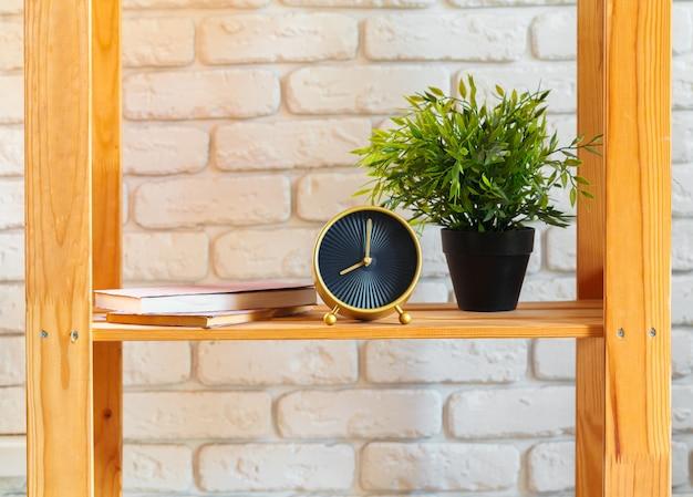 Wooden shelf with home decor on ot Premium Photo