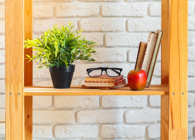 Wooden shelf with home decor with plants Premium Photo