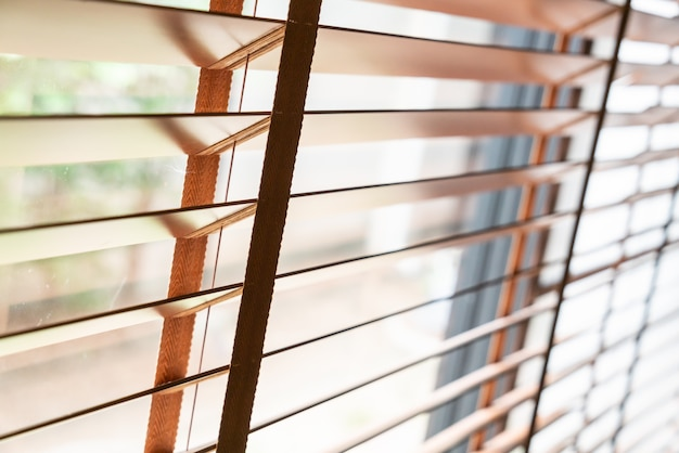 Wooden shutters on the window in the living room | Premium Photo