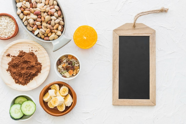 Wooden slate tag with ingredients on white backdrop Free Photo