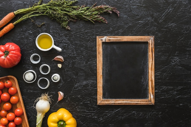 Wooden slate with ingredients on kitchen worktop Free Photo