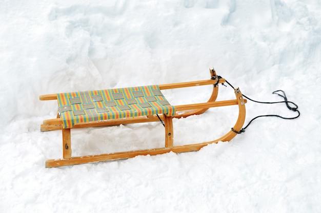 Wooden sled on snow Premium Photo