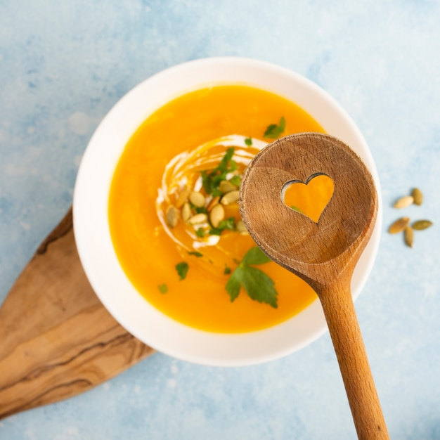 Wooden spoon above delicious soup Free Photo