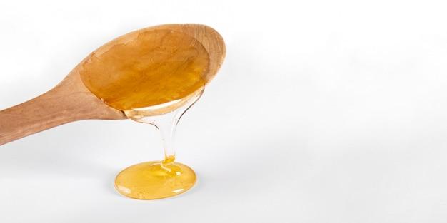 Cucchiaio di legno con miele Foto Gratuite