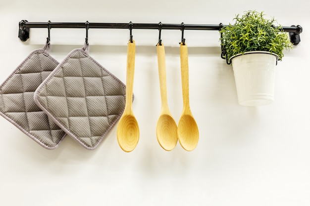 Wooden spoons hanging in the kitchen Premium Photo