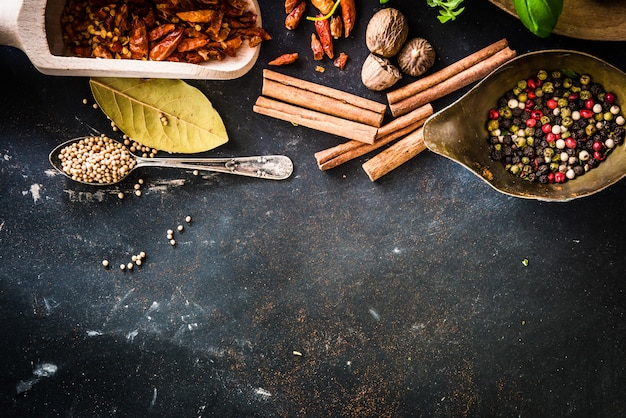 Wooden spoons with spices and herbs Premium Photo