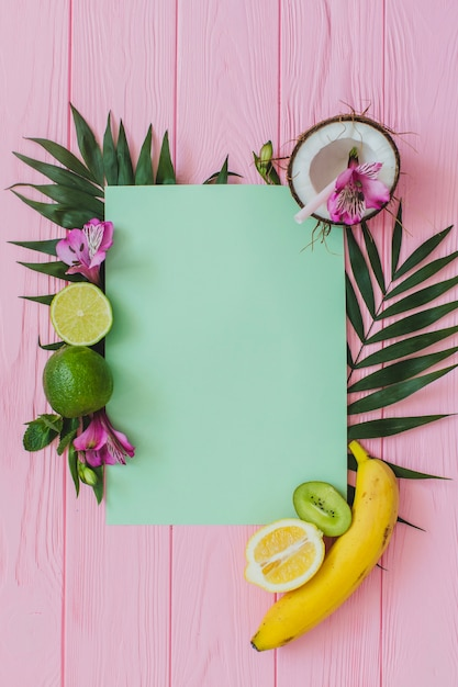 Wooden surface with piece of paper and fruits Free Photo