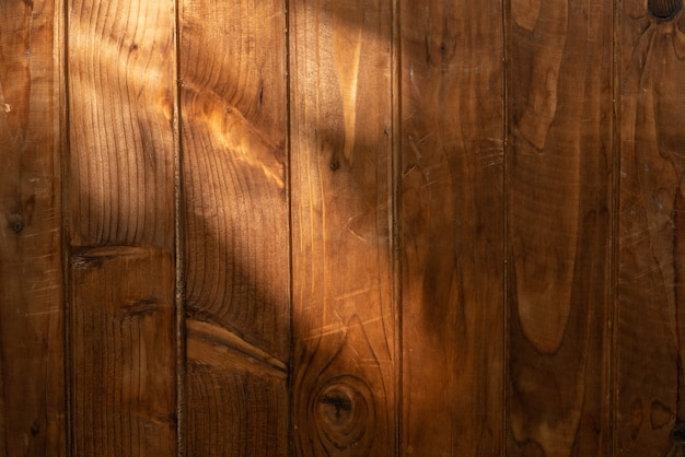 Wooden surface with a ray of light Premium Photo