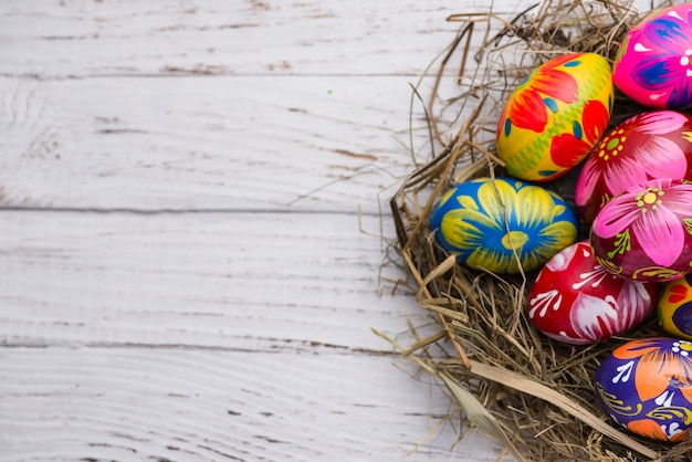 Wooden surface with several easter eggs Free Photo