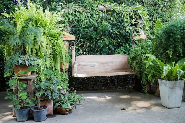 Wooden swing seat in outdoor garden Premium Photo