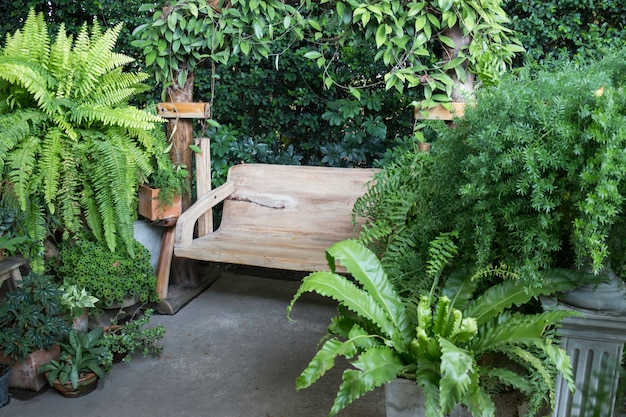Wooden swing seat in outdoor garden Premium Photo