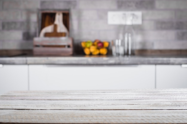 Wooden table on background of kitchen room. place for object, text. Premium Photo