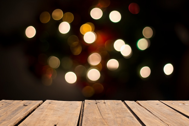 Wooden table in front of abstract blurred ligth Premium Photo