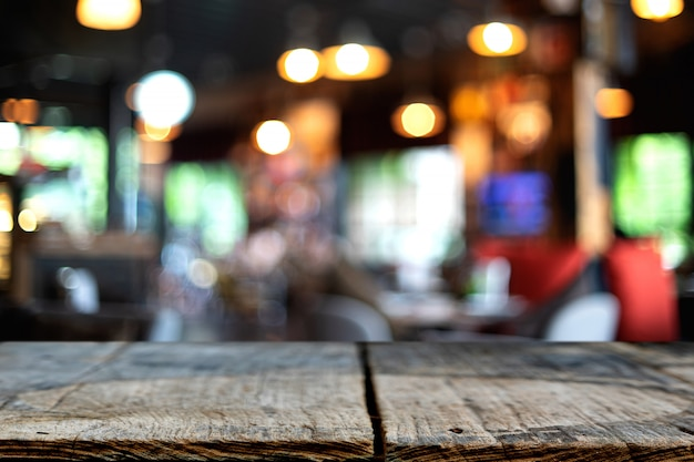Wooden table in front of the blur background Premium Photo