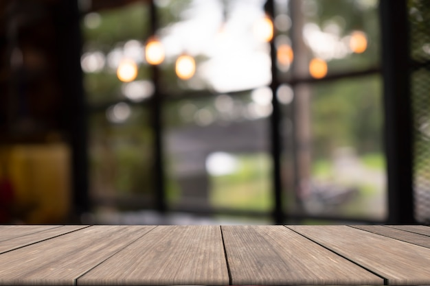 Wooden table on front blurred background Premium Photo