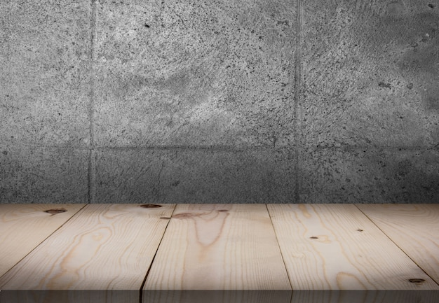 Wooden table in front of wall room Premium Photo