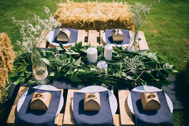 Wooden Table Setup For Garden Party Or Dinner Reception. Premium Photo