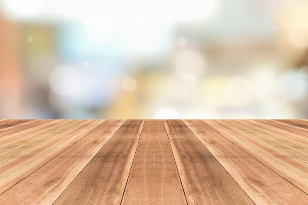 Wooden table top against blurred cafe background Premium Photo