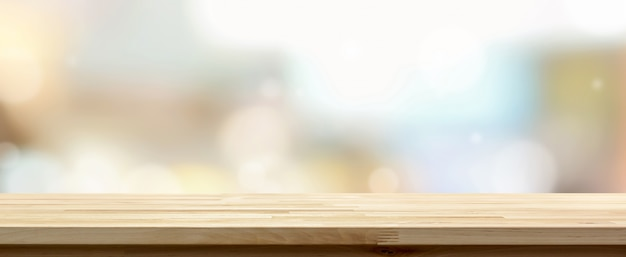 Wooden table top against cafe background Premium Photo