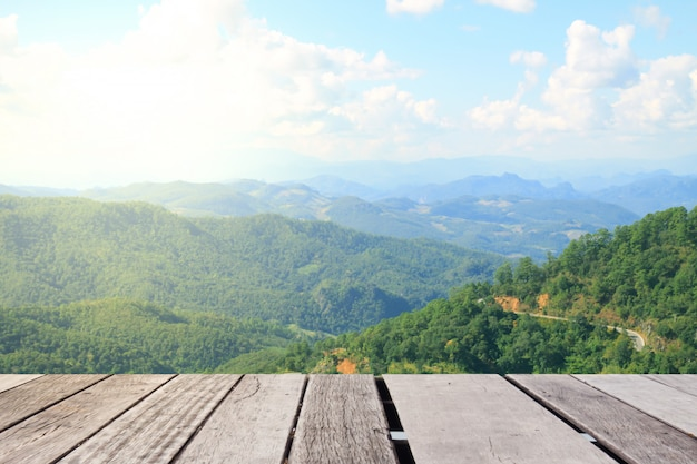 Wooden table top with the mountain landscape Premium Photo