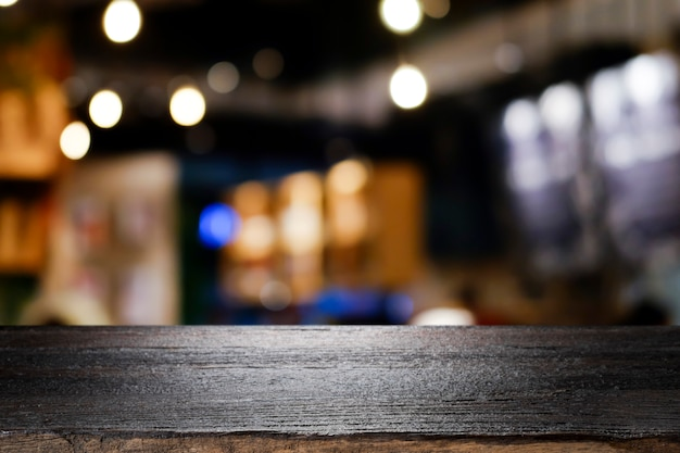 Wooden table with blur background of coffee shop. Premium Photo