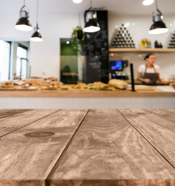 Wooden table with blurred restaurant scene Free Photo