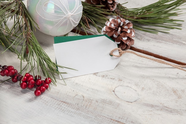 The wooden table with  empty  blank price tag and christmas decorations. Free Photo