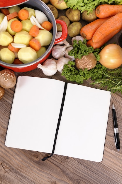 Wooden table with food and notebook photo free download