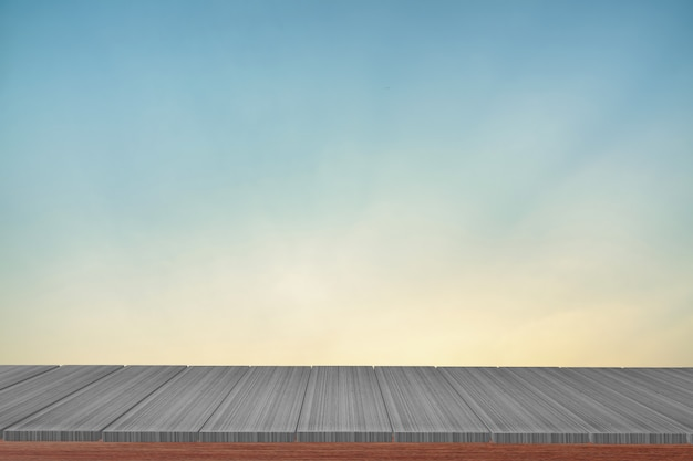 Wooden table with view  blue backdrop.you can used for display products. Premium Photo