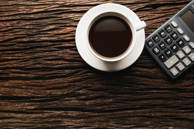 Premium Photo Wooden Table Wooden Desk With Coffee And Calculator Top View Of Coffee Cup On Wooden Background With Copy Space