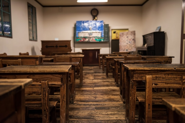 Wooden tables and chairs in classroom Premium Photo