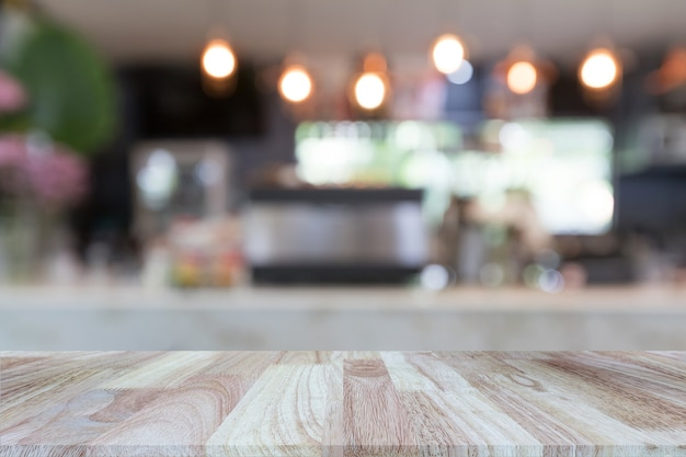 Wooden tabletop on blurred restaurant or coffee shop background Premium Photo