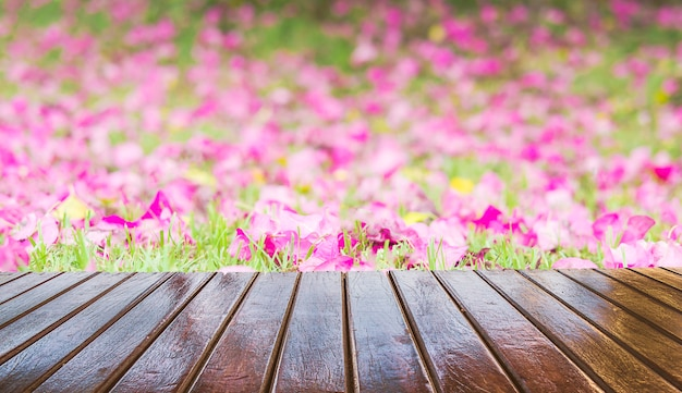 Wooden terrace over beautiful purple flower background Free Photo