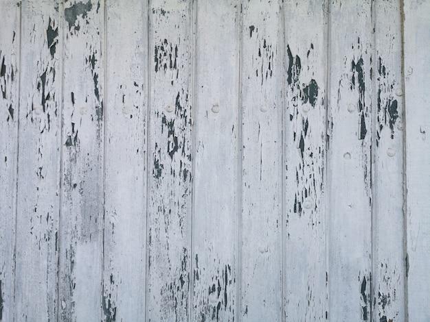 Деревянная поверхность предпосылки текстуры с треснувшей белой краской. Premium Фотографии