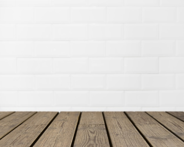 Wooden texture looking out to white brick wall Free Photo