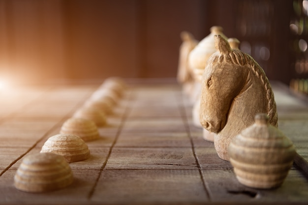 Wooden thai chess on wooden board. strategy and hobby concept. business and leisure theme Premium Photo