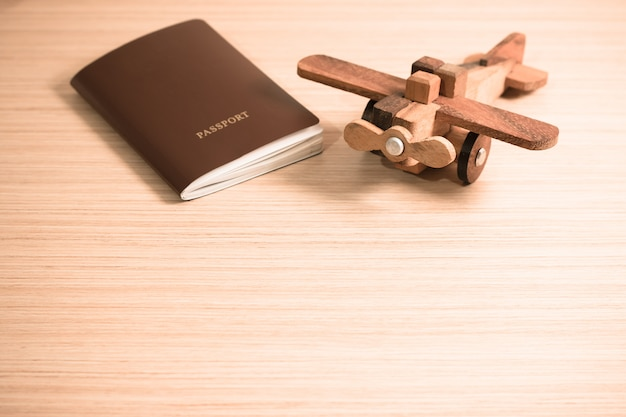 Wooden toy plane and the passport with copy space. travel concept Premium Photo