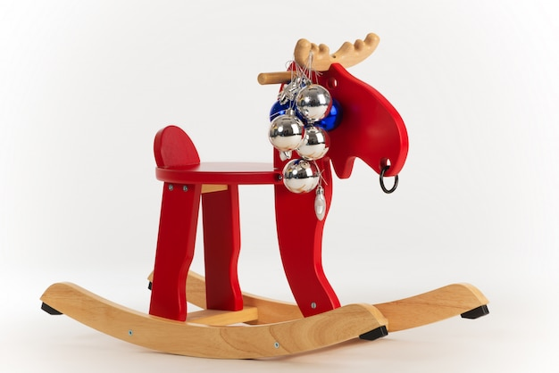 Wooden toy rocking chair red moose Premium Photo