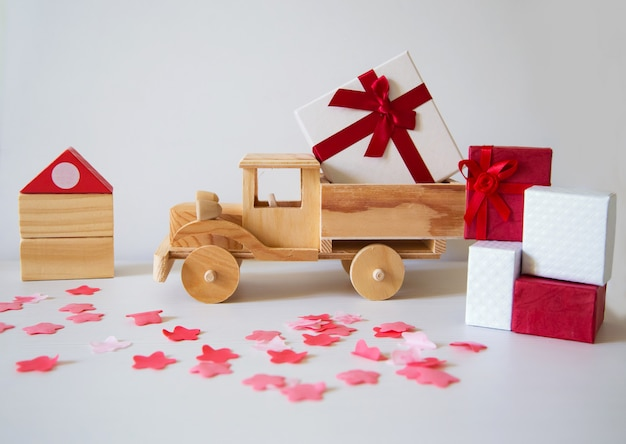 Wooden truck arriving at a house and full of  gifts and packages Premium Photo